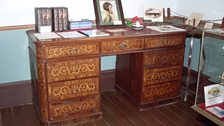 Henry Handel Richardson's writing desk, displaying her portrait by Rupert Bunny