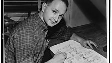 Jules Feiffer, American cartoonist and writer of Carnal Knowledge, seated at work on cartoon