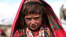 One of the Wakhan Valley children dressed in her best clothes ready for the Kuch -