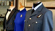 Replica uniform (right) and male/female dress uniforms (left)