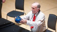 Alvin Lucier holding teapot after performing after performing Nothing is Real (Strawberry Fields Forever).