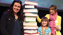 Silver 9 & Under winner Letty Neary Jones with Chris and Susanna Reid, who read her story 'White'