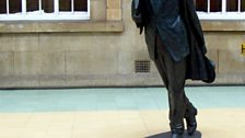 The sculpture of Philip Larkin by Martin Jennings which was erected in Hull Paragon interchange