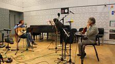 Elaine, Irvine and Alasdair swap instruments
