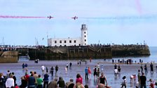 Red Arrows fly over Scarborough Lighthouse
