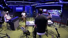 Robin Thicke and his band in the Live Lounge for Sara