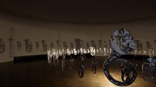 Cornelia Parker, Perpetual Canon, 2004; flattened brass band instruments suspended.