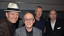 The Clash band members Paul Simonon, Nicky 'Topper' Headon and Mick Jones with Front Row presenter John Wilson