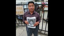 Mr He petitions in Beijing for justice for his dead wife.