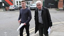 Joe Dempsie and Philip Fox walking home from the factory.