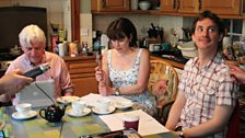Philip Fox, Julia Hills and Ashley Cook get comfortable in the family kitchen