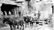 A horse and cart pulling a 4 ton block of beer stone