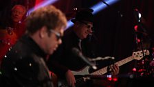 Elton John and the band