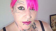 Kazz loves her tattoos