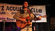 Ed K-T performing at the Open Mic Night