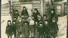 Kindergarten in Norlisk, c 1935 under the poster 'Thank you great Stalin for the happy childhood!'