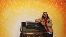 Jeremy Deller with Jukebox, 2013 and mural backdrop by Stuart Sam Hughes