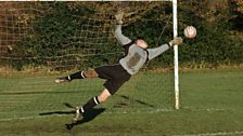 Mary Dendy FC's Matt Robinson makes a flying save