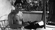 Leonard Bernstein in Hollywood, 1944, with his portable typewriter.