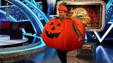 Researcher Will tests out Ian's pumpkin suit in dress rehearsals