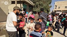 Maqsood hands out sweets in Syria