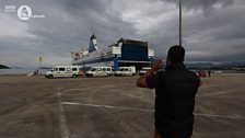 Fazeel Ahmed takes a picture as the convoy arrives in Greece