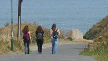 Sarah, Abi and Irum walking downhill