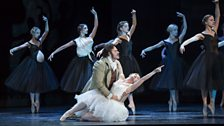Bryan Hymel as Henri with dancers (Act III)