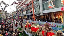 Camels parading through the city