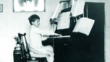Benjamin Britten playing the piano at home in 1921