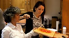 Marina Chapman and her daughter Vanessa prepare a traditional Columbian dish of chicken and chickpeas.