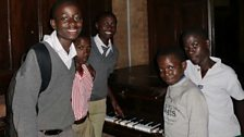 Choirboys from Namirembe Cathedral take their only chance to play the old, but loved piano