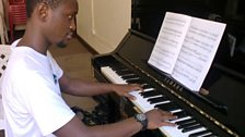 The school benefits bursary students like Shafic who has reached Grade eight piano in just four years