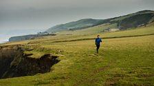 Tom Mathias running along the west Wales coast