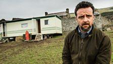 Tom Mathias outside his mobile home