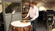 Steve plays an upturned cymbal on a timpani head for a unique sound