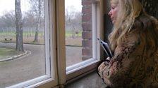 Rev Ruth Scott looking out of window of Barrack Blocks in Auschwitz 1.