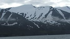Iceland's snow capped mountains across the bay from Husavik.