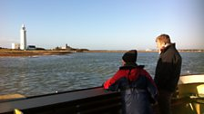 Roberta and Tom watch the lighthouses of Keyhaven meander past