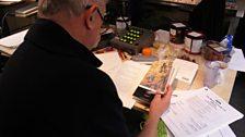 Stephen Wyatt editing scripts in studio