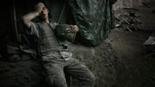 A 2nd platoon soldier rests after fighting at the Restrepo outpost, named after medic Juan Restrepo who was killed in 2007.