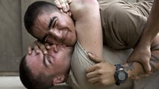 Bobby kisses Cortez during a play fight at the barracks of Second Platoon at the Korengal Outpost.