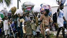 During a government counter-offensive on LURD positions in Monrovia, 3,000 displaced people flee with their possessions.