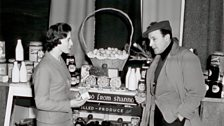 Gene Kelly samples Shannon's duty free produce