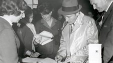 Bing Crosby signs the airport Visitors' Book at Shannon