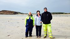 Helen with Tresco Harbour Master Henry Birch (left) and Editor of the Tresco Times, Alasdair Moore (right).