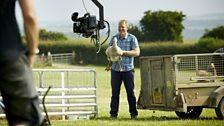 Adam filming on his farm