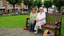 Steph and Jo on a bench in Broseley