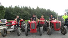 Tractors and their drivers taking part in a vintage tractor run to raise money for charity