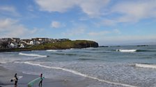Portrush's west strand - surfers come from round the world to surf Ireland's waves, including thousands who come for lessons.